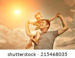 son seating on the father under ... | Shutterstock . vector #215468035
