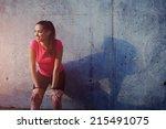 fitness sport girl resting... | Shutterstock . vector #215491075