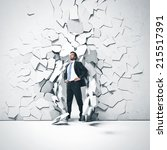 young businessman breaking...   Shutterstock . vector #215517391