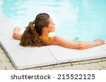 young woman relaxing in... | Shutterstock . vector #215522125