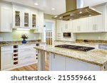 Stock photo modern and practical kitchen room design white cabinet with granite tops kitchen island with 215559661