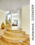 Small photo of Walk-through with round steps in light brown color. Light ivory walls