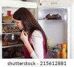 brunnette woman holding foul... | Shutterstock . vector #215612881