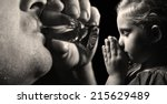 child prays that father stopped ... | Shutterstock . vector #215629489