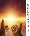 hands reaching for the sky | Shutterstock . vector #215656399