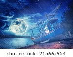 ship on the beach in full moon... | Shutterstock . vector #215665954
