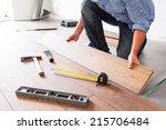 man installing new laminated... | Shutterstock . vector #215706484