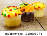 Row of autumn cupcakes on a wooden table - stock photo