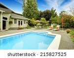 Backyard With Swimming Pool An...
