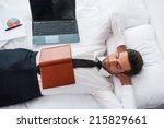 businessman sleeping. top view...   Shutterstock . vector #215829661
