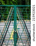 Small photo of Locked green gate on an access road