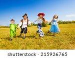 happy kids run wearing costumes ... | Shutterstock . vector #215926765
