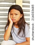 cute homeless sad child sitting ... | Shutterstock . vector #216033685