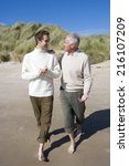 two men discussing on beach | Shutterstock . vector #216107209