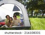 family looking at map in tent | Shutterstock . vector #216108331
