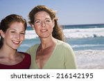 mother and daughter on beach   Shutterstock . vector #216142195