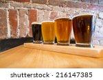 flight of four beers for... | Shutterstock . vector #216147385
