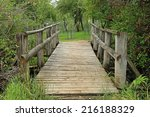 Rustic Wooden Bridge Leading T...