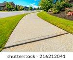 curved pedestrian sidewalk in a ... | Shutterstock . vector #216212041