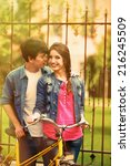 young couple with bicycle... | Shutterstock . vector #216245509