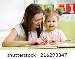 mother and child girl read a... | Shutterstock . vector #216293347