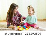 happy mom and kid play toys at... | Shutterstock . vector #216293509