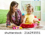 happy mother and kid play at... | Shutterstock . vector #216293551