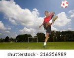 teenage girl in uniform kicking ... | Shutterstock . vector #216356989
