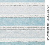 Ivory Lace Fabric On Blue...