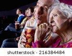 senior couple sharing drink in... | Shutterstock . vector #216384484