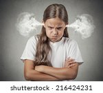 Small photo of Closeup portrait Angry young girl Blowing Steam coming out of ears about to have Nervous atomic breakdown isolated grey background. Negative human emotions Facial Expression feeling attitude reaction