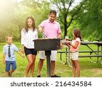dad grilling food for wife and... | Shutterstock . vector #216434584