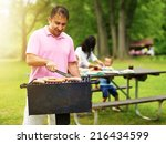 father grilling hot dogs and... | Shutterstock . vector #216434599