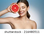 Smiling Girl With Grapefruit ...