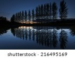 Line Of Trees Reflected On Lak...