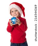 Little boy with christmas hat and blue decoration in hands - stock photo