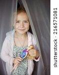 Little Cute Blond Girl Play...
