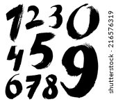 black handwritten numbers on... | Shutterstock . vector #216576319