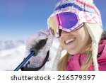 smiling skier adjusting goggles | Shutterstock . vector #216579397