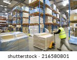 Warehouse Worker Pushing Palle...