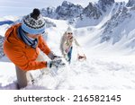 smiling couple with sled... | Shutterstock . vector #216582145