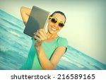 girl photographs selfie on the... | Shutterstock . vector #216589165