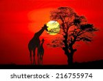 Setting Sun With Silhouettes O...