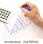 hand draws a graph of blue  the ... | Shutterstock . vector #216785431