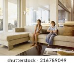 a boy and girl sitting on sofa | Shutterstock . vector #216789049