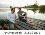 two friends relaxing on the... | Shutterstock . vector #216791011