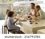 A Family Having Breakfast.