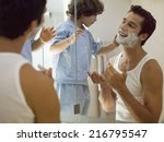boy applying shaving foam on... | Shutterstock . vector #216795547