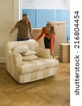 couple adjusting an armchair... | Shutterstock . vector #216804454