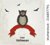 scary owl sitting on red ribbon ...   Shutterstock .eps vector #216857791